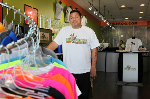 Tribal business owner Jason Billie poses in his Big Frog Custom T-Shirts & More store located at 1614 Sheridan St. in Hollywood.