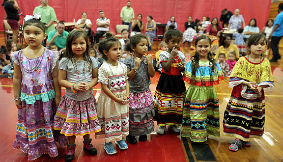 Girls from the Hollywood Preschool 4- and 5-year-old classes line up to be judged in a clothing contest during Indian Day festivities geared just for kids.