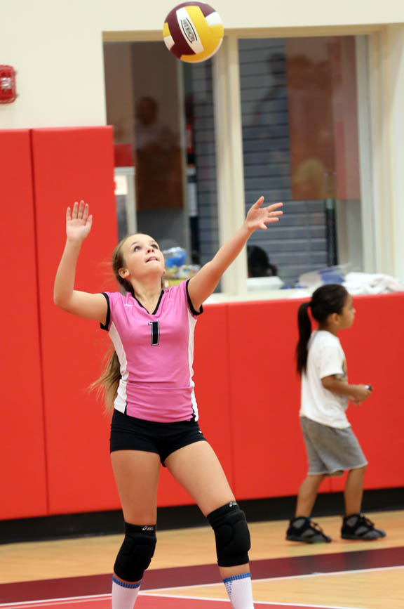Pemayetv Emahakv Charter School eighth-grader Jenna Brown delivers a serve in the team's season finale Oct. 6 against Clewiston Middle School.