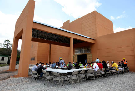 Workers and managers gather for a hearty barbecue lunch Oct. 20 at the Big Cypress Medical Center, which is under construction. The midday meal marked the near halfway point to the project completion, set approximately for late spring 2016.