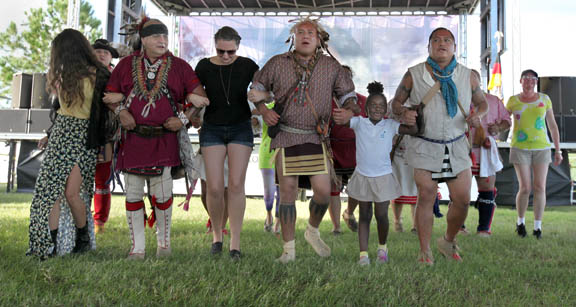 The Warriors of AniKituhwa, tribal ambassadors of the Eastern Band of Cherokee in North Carolina, and spectators of the 18th annual American Indian Arts Celebration at the Ah-Tah-Thi-Ki Museum on Big Cypress join in a harvest dance Nov. 7.