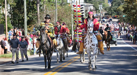 Moses Jumper Jr. and Osceola (Brendan Carter) and his horse Renegade – joined by Seminole warrior riders and mounted law enforcement – lead the Nov. 13 Florida State University homecoming parade through the streets of Tallahassee.