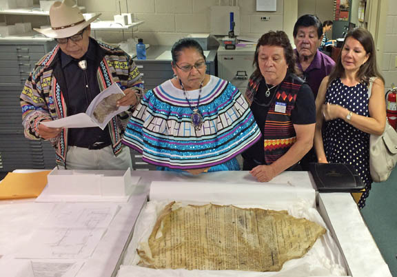 From left, Pete Osceola Jr., Virginia Osceola, Lee Tiger, Wayne Billie and Yolima Tiger examine the Buckskin Declaration of Independence that Miccosukee leader Buffalo Tiger brought to President Dwight Eisenhower in 1954. The declaration returned to Florida after 61 years in Kansas and will be on display at the Ah-Tah-Thi-Ki Museum in Big Cypress in January.