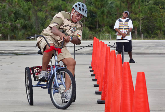 Big Cypress' Jonah Cypress carefully negotiates the cone weave Nov. 19 during the 11th annual Trike Fest in Big Cypress.