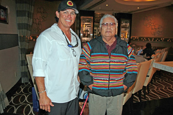Hollywood Councilman Chris Osceola poses Nov. 4 with outgoing Gaming Commission member Truman Bowers, who dons a patchwork jacket presented to him by Councilman Osceola, during a farewell dinner at the Chef's Table at Seminole Hard Rock Hotel & Casino Hollywood.