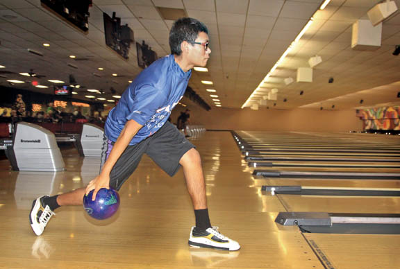 Arek Jumper, 16, of Hollywood, warms up Dec. 9 prior to bowling in the Strikers Youth Sport Bowling League in Sunrise.