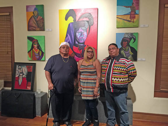 From left, Jimmy Osceola, Stephanie Hall and Elgin Jumper pose in the artists gallery Nov. 16 at New River Inn in Fort Lauderdale.