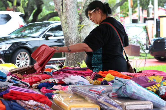Rhonda Jumper looks through piles of fabric Dec. 1 at Judybill Osceola's garage sale in Hollywood to benefit the Jerusalem Prayer Team.