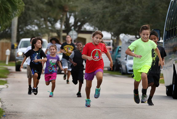 And they're off. Energetic children lead the pack Dec. 17 at the start of the Jingle Bell Jog in Hollywood. The Health Department hosted the 5K event to help keep health and fitness a priority during the holiday season.