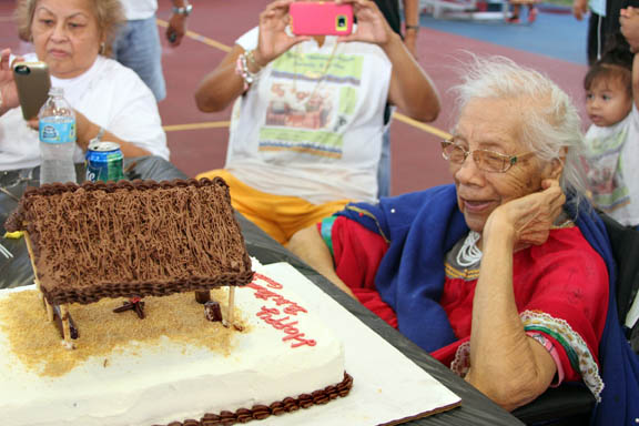 Surrounded by family and friends, Hollywood elder Maggie Osceola celebrates her 95th birthday at the Hollywood ball field and airnasium.