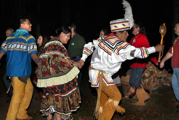The Henry family, led by medicine man Bobby Henry, leads an inter-tribal Stomp Dance around a bonfire Dec. 13 during the annual Winter Solstice Celebration. Seminole Tribe members and historians gathered in Tallahassee to correct inaccuracies about Seminole history.