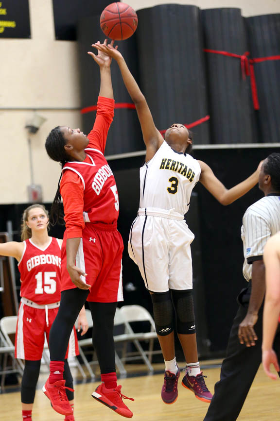 American Heritage eighth-grader Tiana Stubbs vies for the tip at the start of the Patriots' girls junior varsity basketball game against Cardinal Gibbons Dec. 14.