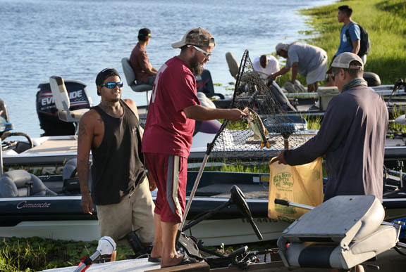 Fishermen beach their boats on the bank of a Big Cypress canal to bring their catch to the weigh-in Dec. 29 at the Big Cypress First Baptist Church fishing tournament.