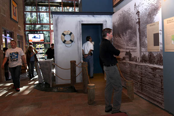 Guests observe the 'Struggle for Survival: 1817-1858' exhibit, which includes a re-creation of the Grey Cloud steamer used to transport Natives to Oklahoma, Jan. 16 at Ah-Tah-Thi-Ki Museum in Big Cypress.