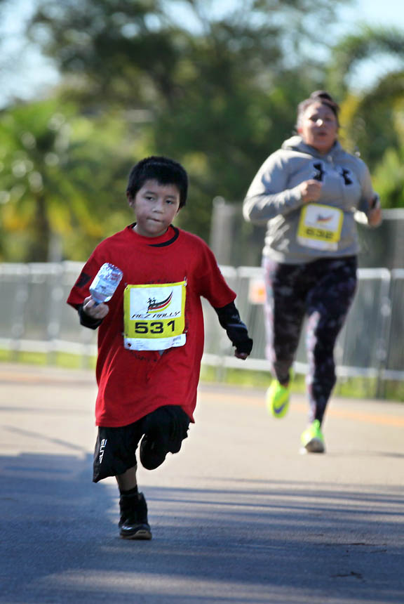 Curtis Motlow, 6, of Big Cypress, dashes toward the finish line at Rez Rally. He was the youngest participant in the race and came in first in the tribal 6-11 age category.