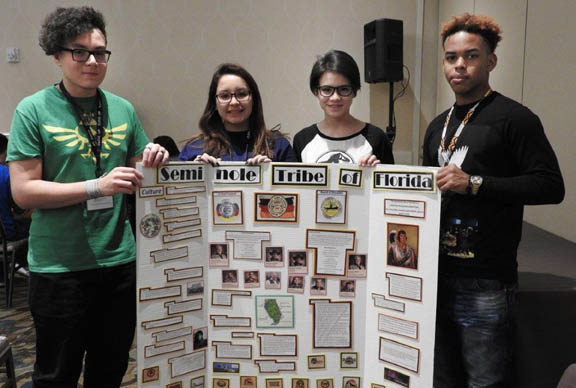 Seminole Tribe teens Deven Osceola, 15, Marsha Osceola, 18, Nicole Slavik, 16, and Tyrek Lasane, 17, show a poster board they created during Close Up's Washington, D.C. program. (Photo courtesy of Ruth Osceola.)