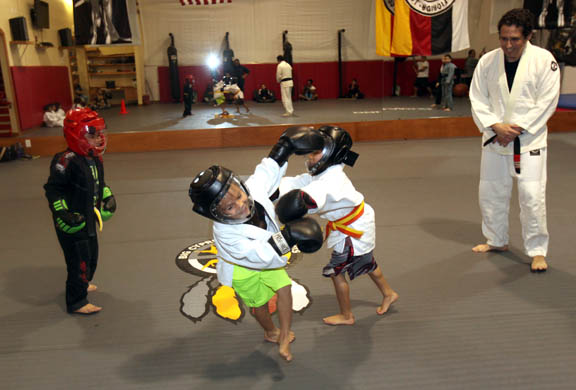 Youngsters battle with gloves and helmets during a session in January at Big Cypress Martial Arts in Big Cypress. Based at the Fitness Dome, the program also offers sessions for adults. From left are Zayden Cypress, Clint Billie and Curtis Motlow.