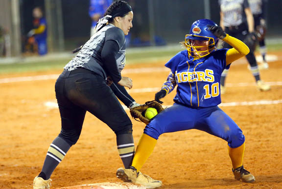 Moore Haven High School first baseman Kalgary Johns applies a tag against Clewiston High School's Megan Pittman in the third inning of the Lady Terriers' 7-5 win Feb. 22 in Clewiston.