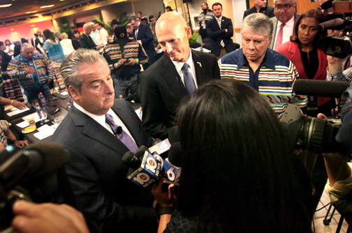 Seminole Gaming CEO Jim Allen, Gov. Rick Scott and Chairman James E. Billie answer questions from the media Feb. 1 during a press conference in Hollywood.