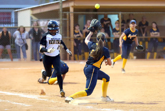 American Heritage's Kiauna Martin tries to beat out a bunt March 16 against St. Thomas Aquinas. The Patriots cranked out 14 straight wins before suffering their first setback, 5-1, at St. Thomas Aquinas.