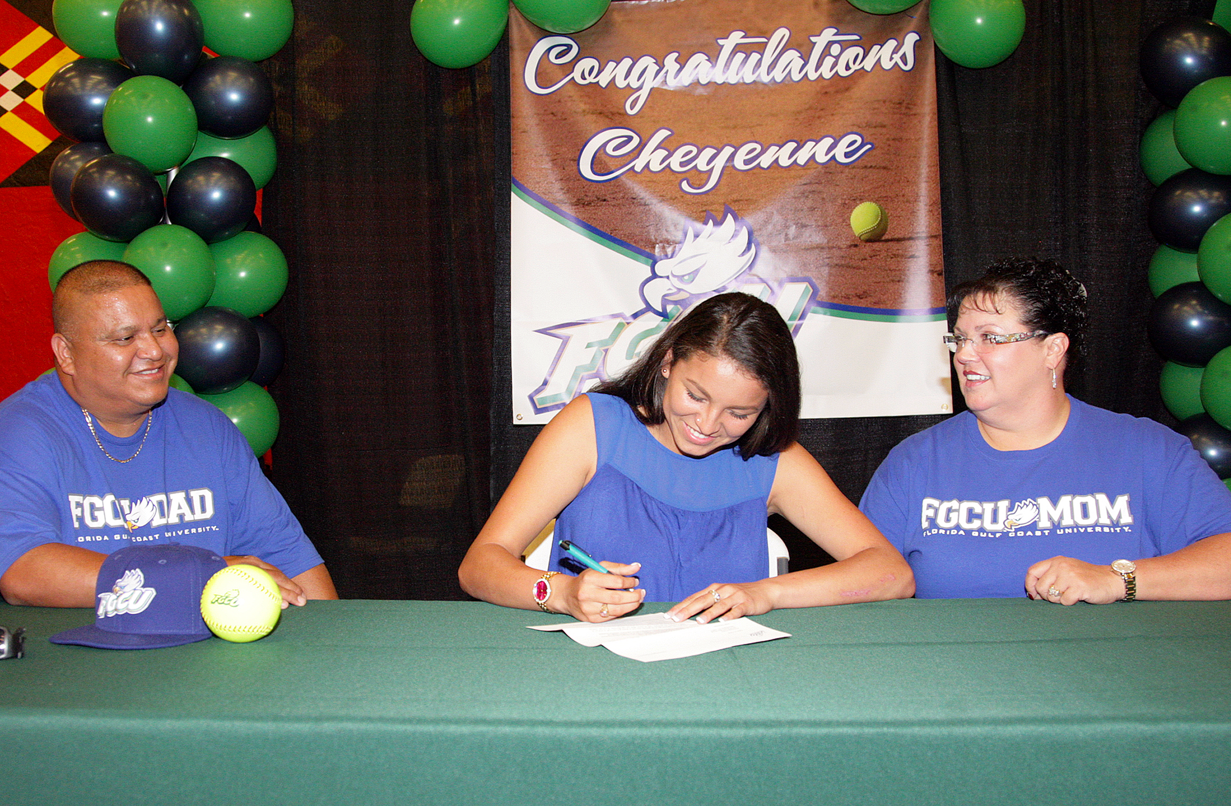 With her parents Daniel Nunez Sr. and Peggy Nunez at her side, Okeechobee High School senior softball player Cheyenne Nunez, of the Brighton Reservation, signs a letter of intent to play for Florida Gulf Coast University during a ceremony April 17 at the Brighton gymnasium.