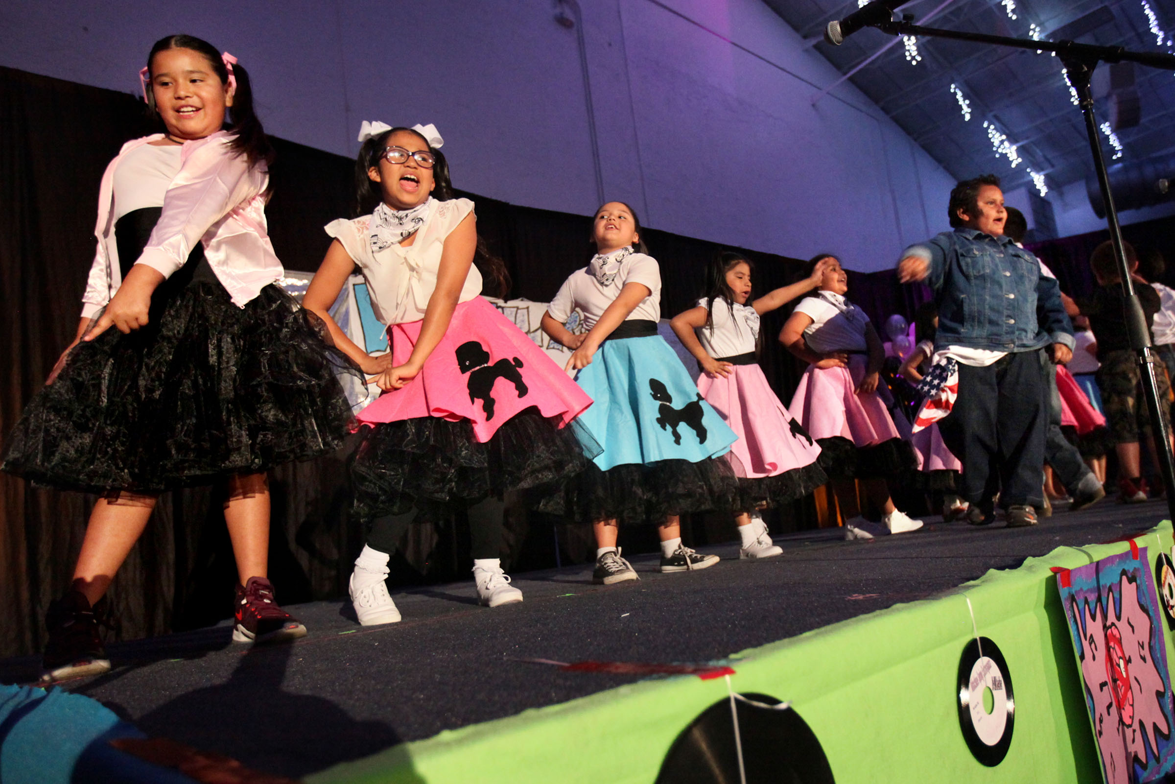 """Poodle skirts and grease slicked hair made authentic 1960s costumes for a super-charged rendition of Elvis Presley's hit song """"Hound Dog"""" by Ahfachkee School second grade students."""