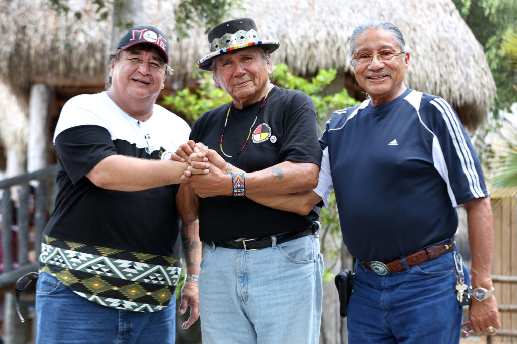 Hollywood Board Rep. Steve Osceola, American Indian Movement co-founder Dennis Banks, and President Mitchell Cypress meet at Billie Swamp Safari in Big Cypress where the Tribe hosted the Longest Walk 5 participants June 4.