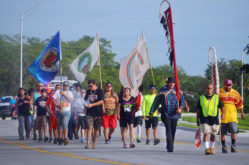 Tribal members join participants in the Longest Walk 5 as they walk through Big Cypress Reservation June 5. The purpose of the 3,600-mile coast-to-coast walk is to end drug abuse and domestic violence in Indian Country.