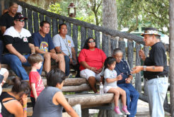 Longest Walk 5 leader Dennis Banks talks about the mission of the walk to Seminole citizens at Billie Swamp Safari June 4. (Beverly Bidney photo)