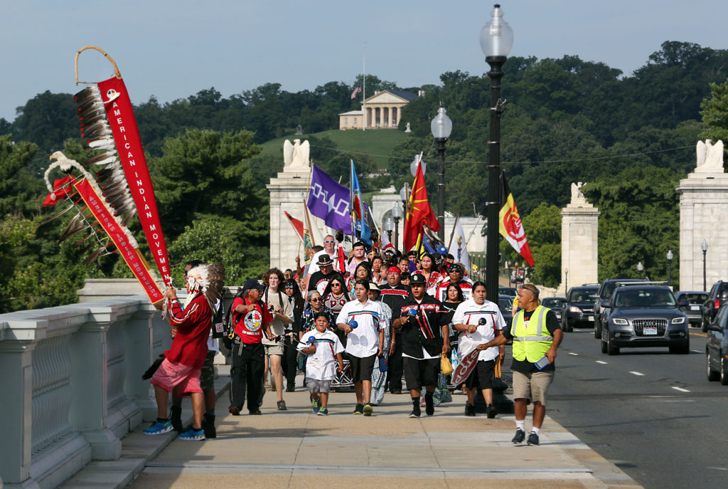 The Longest Walk 5 crosses the Arlington Memorial Bridge from Arlington National Cemetery to the Lincoln Memorial in Washington, D.C. on July 15 after a 3,600-mile journey that began in February in California. The goal of the journey was to raise awareness and find cultural solutions to substance abuse and domestic violence plaguing Indian Country.