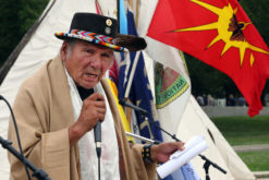 American Indian Movement leader Dennis Banks addresses the crowd at the culminating event of the Longest Walk 5, Visions: A call to Action rally at the Lincoln Memorial July 15.