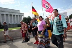 Members of We Do Recover Charlie Tiger, Kenny Tommie, Arnie Gore and Christopher Billie pose for a photo with American Indian Movement founder and leader Dennis Banks of the Longest Walk 5 as they arrive at the Lincoln Memorial in Washington, D.C. on July 15.