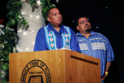 Emcees Wovoka Tommie, left, and Lewis Gopher watch the contestants in the 59th annual Miss Florida Seminole Pageant July 23 in Hollywood.
