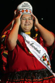 Kirsten Doney adjusts her crown after she was named Miss Florida Seminole at the 59th annual Miss Florida Seminole Pageant July 23 in Hollywood.