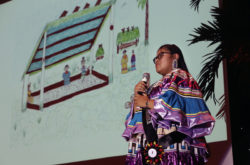 Thomlynn Billie shows off her artwork as she tells a Seminole story during her talent demonstration at the Miss Florida Seminole Pageant.