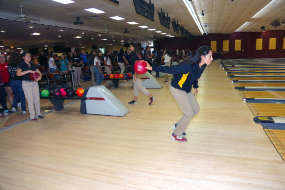 American Heritage senior Ahnie Jumper delivers a practice shot prior to the team's match against Douglas High School on Sept. 20 at Sawgrass Lanes in Tamarac.
