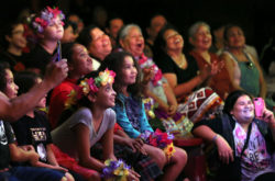 """Tribal citizens, young and young at heart, laugh heartily at the antics of a comedic magician during a night out Oct. 11 in Fort Lauderdale that featured a cruise up the New River aboard the Jungle Queen riverboat plus dinner and a show at the tourist attraction's oak hammock """"island"""" steeped in Seminole memories."""