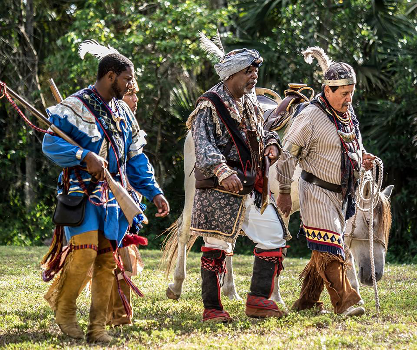Moses Jumper Jr., far right, joins actor Ralph Smith, center, and other cast members during the filming of the documentary 'Suwannee Warrior' on the Big Cypress Reservation. (Claire Powell photo)