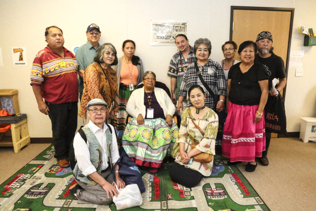 Chief Justice Willie Johns, far left, stands next to Dennis Wiedman, FIU Instructor for the Department of Global and Sociocultural Studies, along with members of the Ainu people and Seminoles from the Creek School in Brighton. (Stephanie Rodriguez photo)