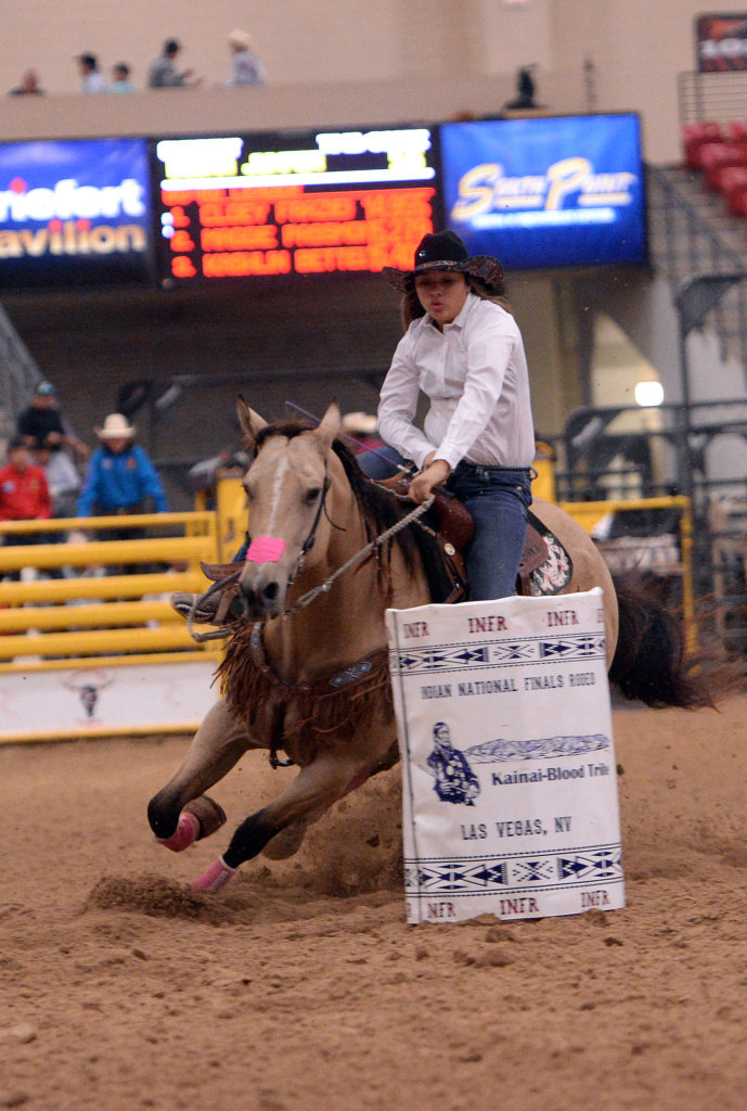 Budha Jumper and her horse compete in junior barrels at iNFR. (Smith Rodeo Photography)