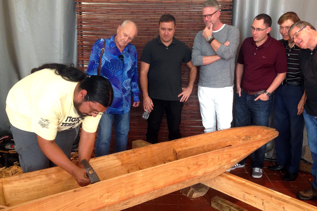 Pedro Zepeda explains his wood canoe-carving project to guests from the Work Matters group that gathers at the Upper Room Art Gallery in Fort Lauderdale. (Robin Haines Merrill photo)