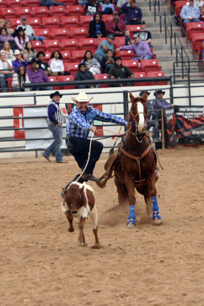 Justin Gopher competes in tie-down roping at INFR in Las Vegas. (Smith Rodeo Photography)