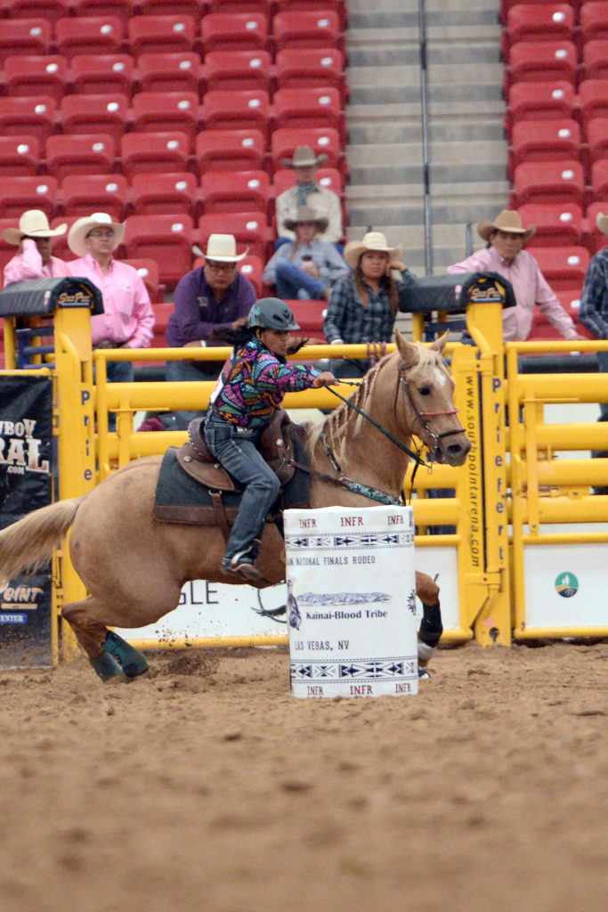 Loretta Peterson competes in barrel racing at INFR in Las Vegas. (Smith Rodeo Photography)