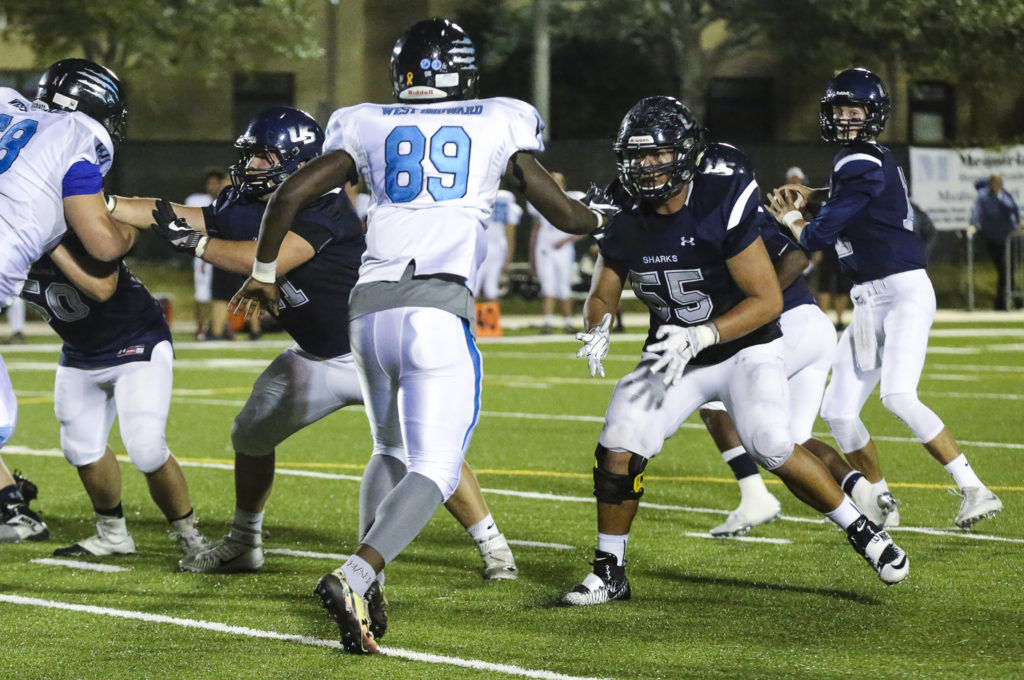 University School senior offensive lineman Brady Latchford (55) provides protection during the team's final game of the season against West Broward on Nov. 4 in Davie. Brady, a starter and captain, played three years of varsity football. (Stephanie Rodriguez photo)