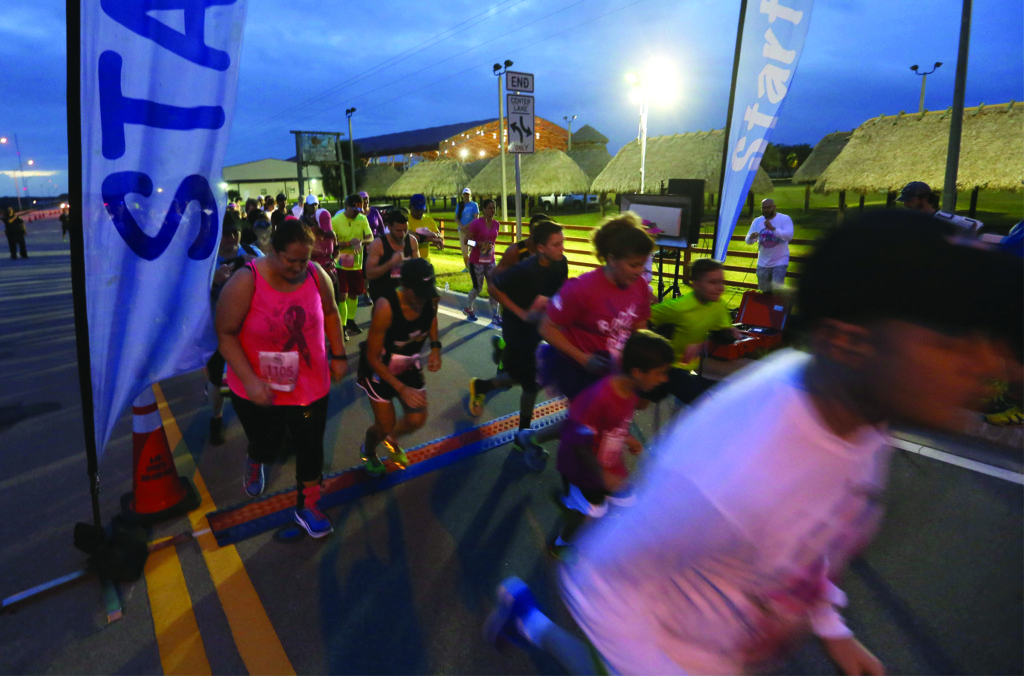 Runners of all kinds take off at the start line in the Pink Panther Prowl, a 5K and 10K run, walk, or stroll Oct. 30 through the Big Cypress. The event also featured the first Seminole Hard Rock Half Marathon. (Eileen Soler photo)