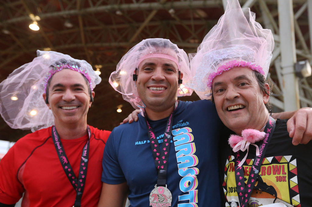 Three friends from the United States Citizenship and Immigration Services ran dressed in pink veils and other pink accessories Oct. 30 for breast cancer awareness in the Pink Panther Prowl, a 5K and 10K run, walk, or stroll through the Big Cypress. The event also featured the first Seminole Hard Rock Half Marathon to support the fight against breast cancer. (Eileen Soler photo)