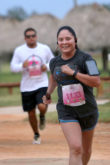 Seminole Tribe citizens Lorraine Posada, right, and Trevon Marks and dash toward the finish line Oct. 30 in the Pink Panther Prowl, a 5K and 10K run, walk, or stroll through the Big Cypress. (Eileen Soler photo)