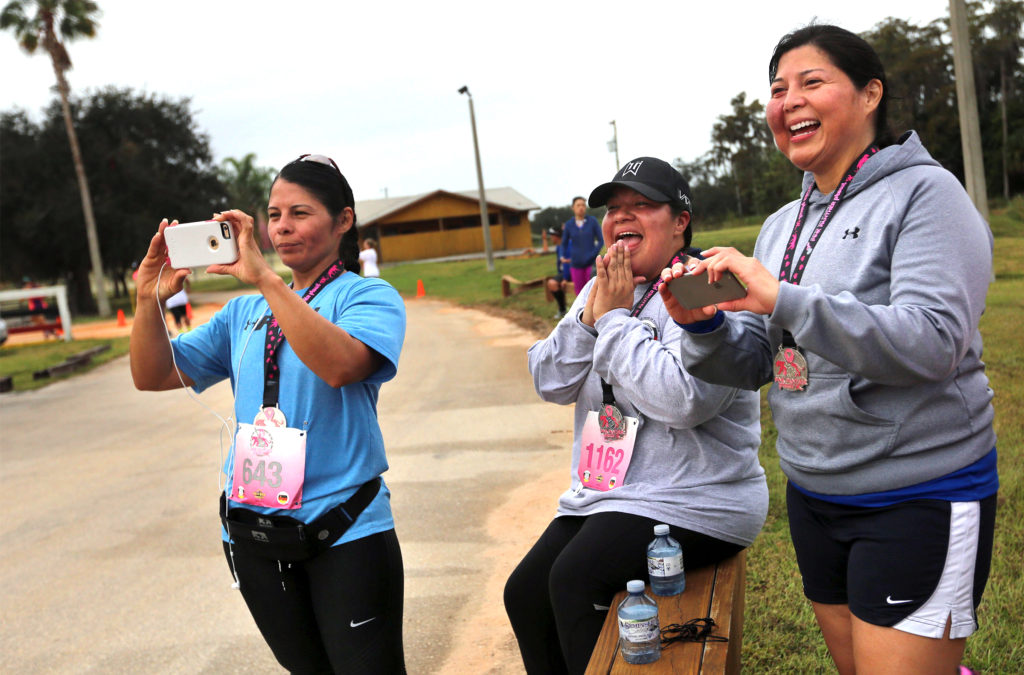 Already finished running the Oct. 30 Pink Panther Prowl (5K and 10K), family and friends line the roadway and cheer on other participants. (Eileen Soler photo)