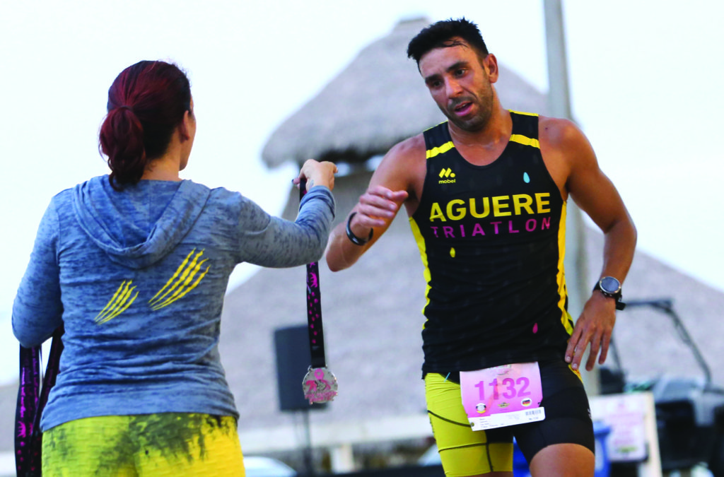 Airan Peraza, of Spain, is the first to cross the finish line in the Pink Panther Prowl 5K held Oct. 30 on the Big Cypress Reservation. (Eileen Soler photo)