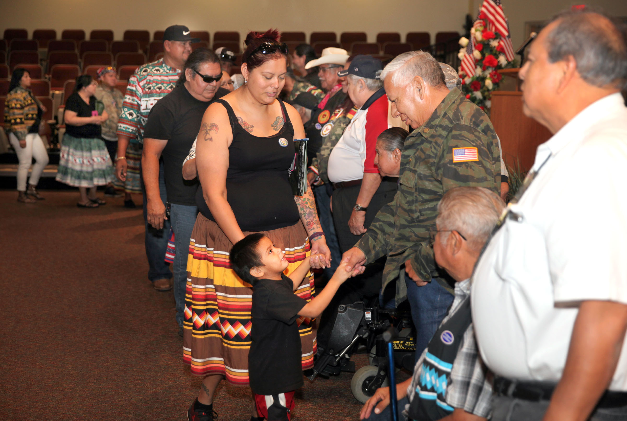 Tribal military veterans, including Brighton Councilman Andrew J. Bowers Jr., greet well-wishers at the 29th annual Brighton Veterans Day celebration Nov. 3. (Beverly Bidney photo)